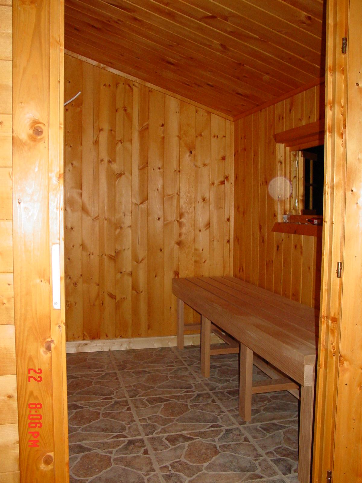 Heavy duty board-log garden shed. Dimensions 8'x12'x7'h.